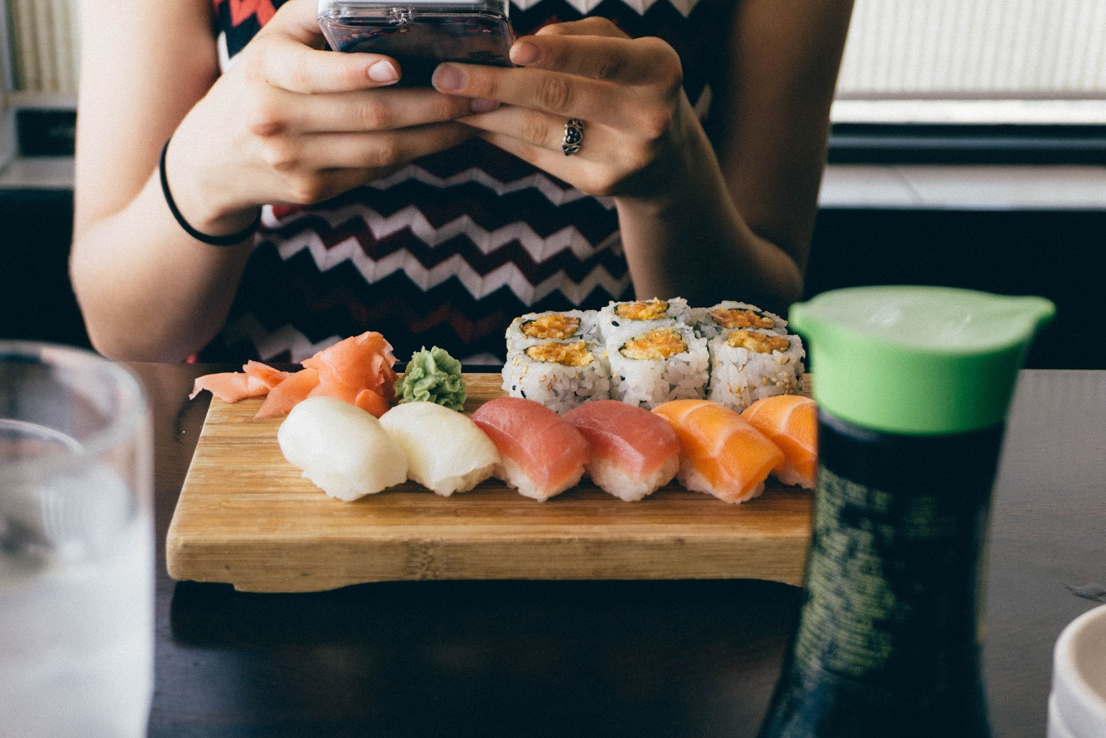 Restaurant customer eating sushi
